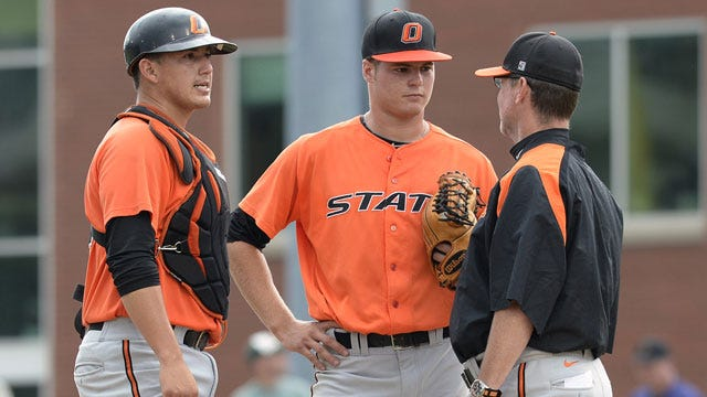 Cowboys Fall To Miami In NCAA Opener