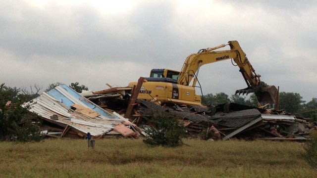 Crews Demolish Choctaw Home Being Swallowed By River