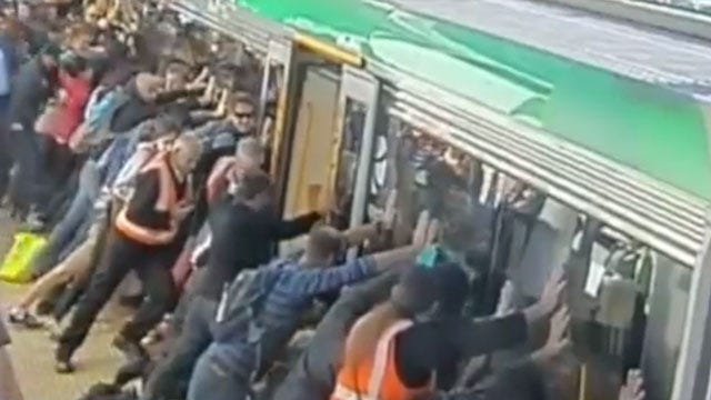 Commuters Tip Train Car To Help Rescue Trapped Man