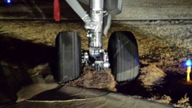 Denver-Bound Plane Stuck In Mud At Will Rogers Airport