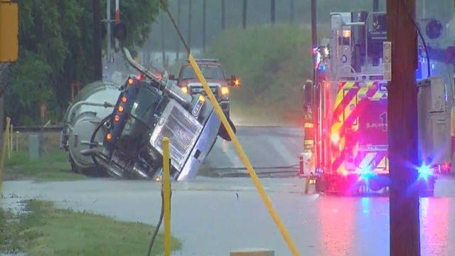 Semi-Truck Carrying Cement Overturns On Flooded Road In Del City