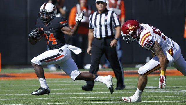 Hill's Kick Return TD Helps Cowboys Run Past Iowa State