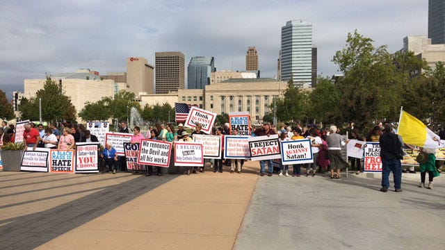 Hundreds Turnout To Protest Black Mass Held At OKC Civic Center