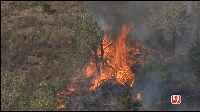 Downed Power Lines Spark Grass Fire In Norman