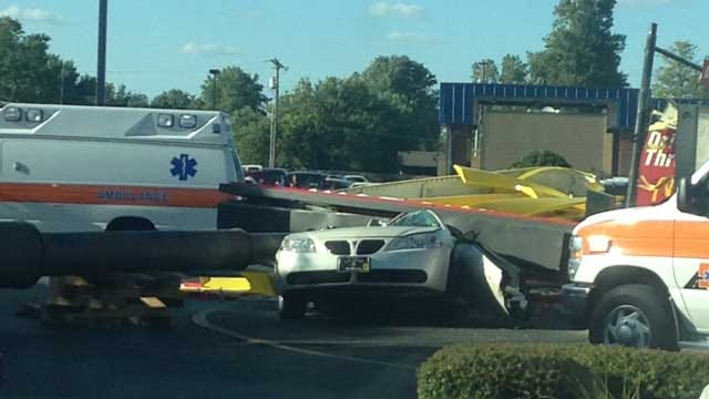 Two Injured After McDonald's Arch Crashes Down In Weatherford