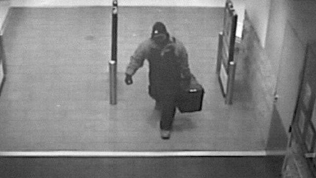 Suspect Sought In Mustang Bank Robbery