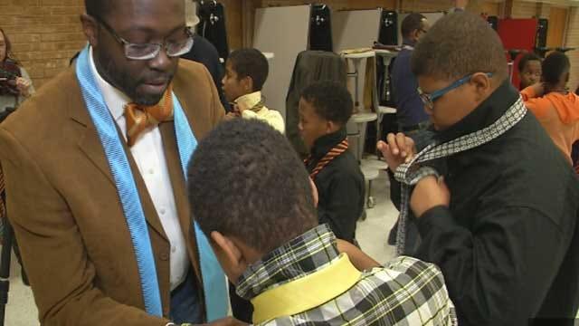 Volunteers Teach Elementary Students How To Tie A Tie