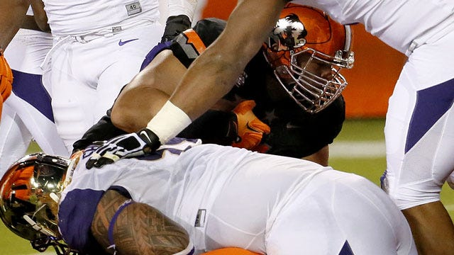 Castleman's Offense Helps Cowboys Tame Huskies In Cactus Bowl