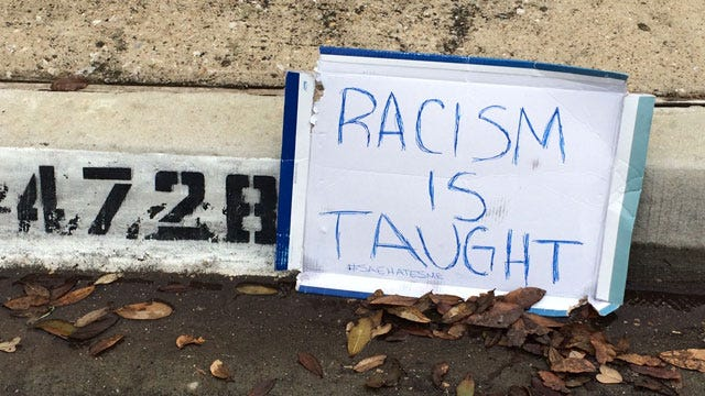 Dallas Protester Leaves Sign At Home Of Former OU SAE Member
