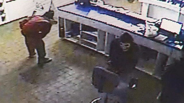 Police Search For Two Masked Suspects Who Robbed A Metro PCS