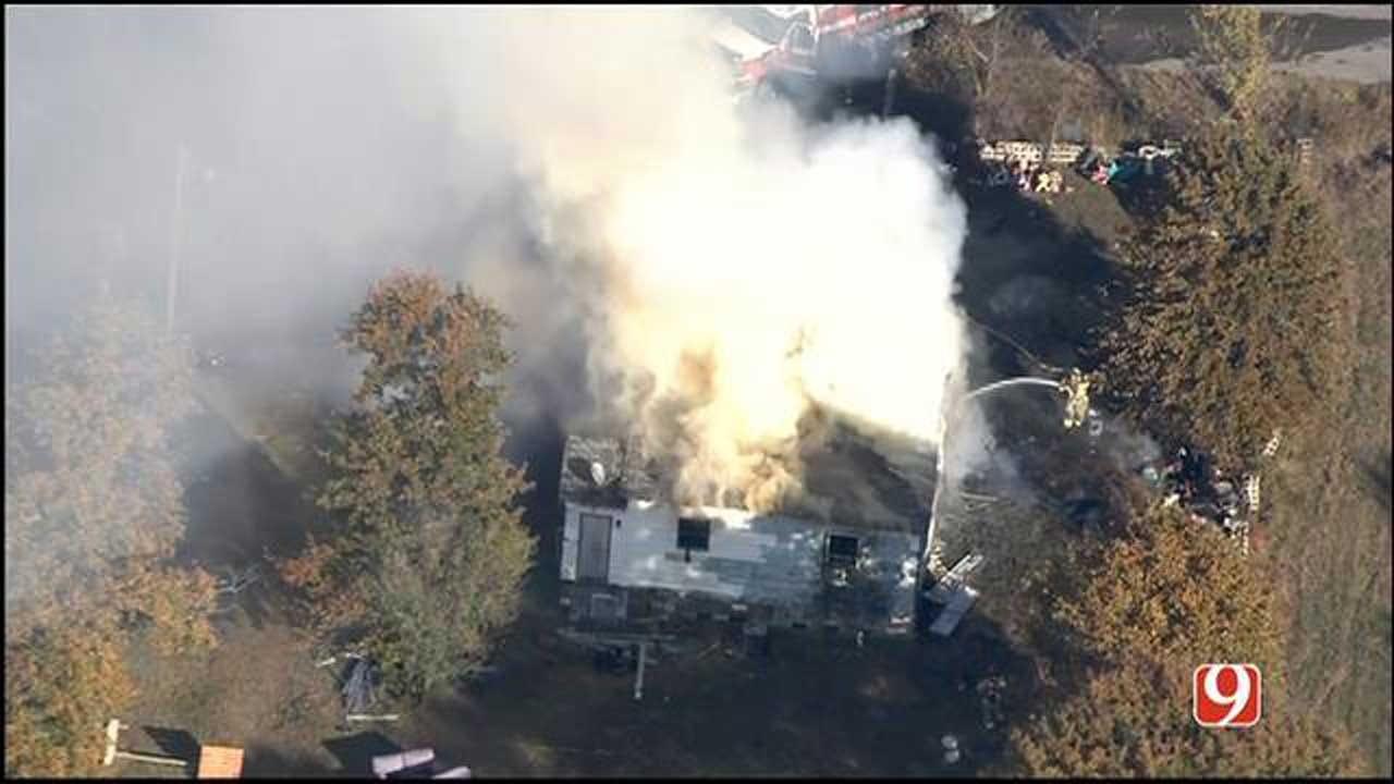 Fire Crews Battle Blaze At Spencer Home
