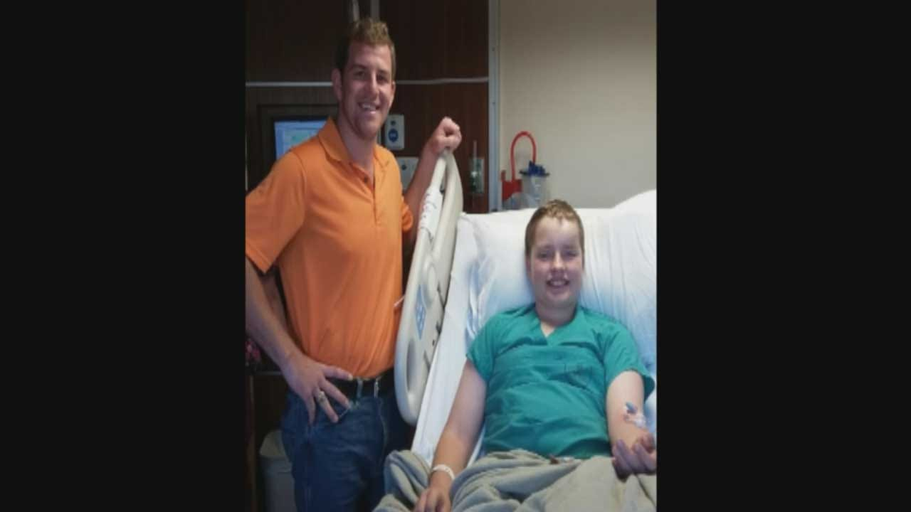 Hero In Orange Helps Young OSU Parade Victims