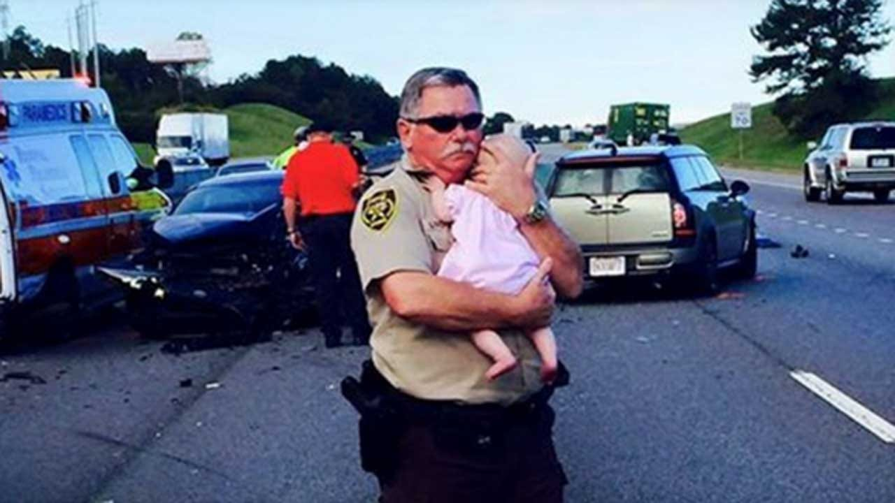 Deputy Comforts Crying Baby After Traffic Accident In Alabama