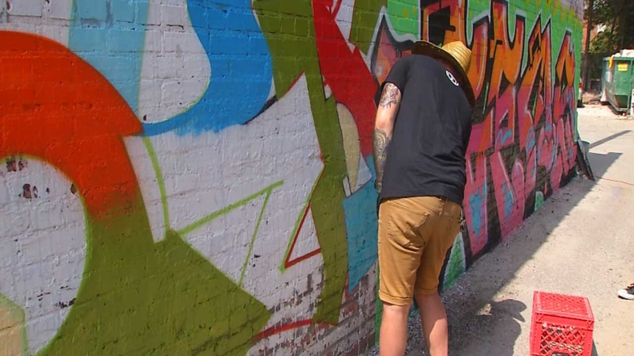 Artists Paint Plaza District's First Urban Art Mural