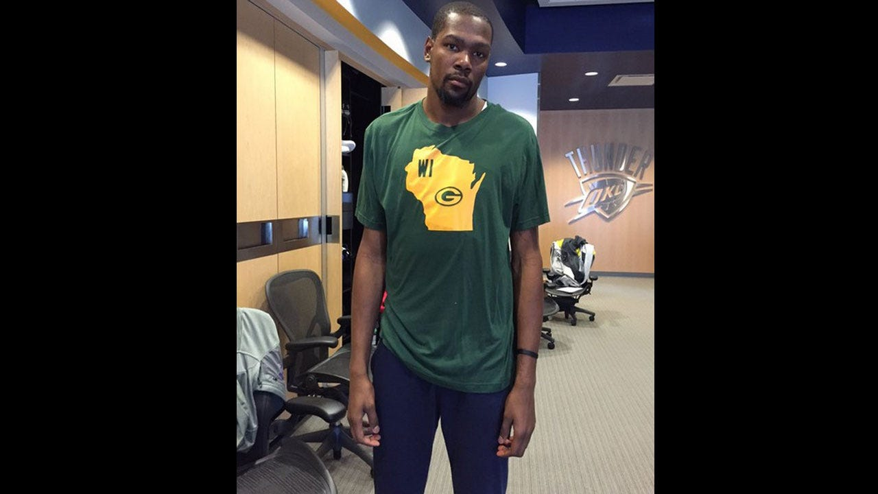 KD Makes Good On Bet With Novak, Wears Packers Shirt