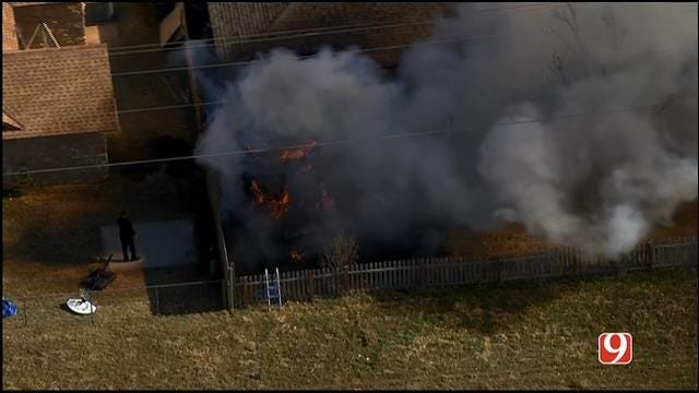 Grass Fire Catches Edmond Home On Fire