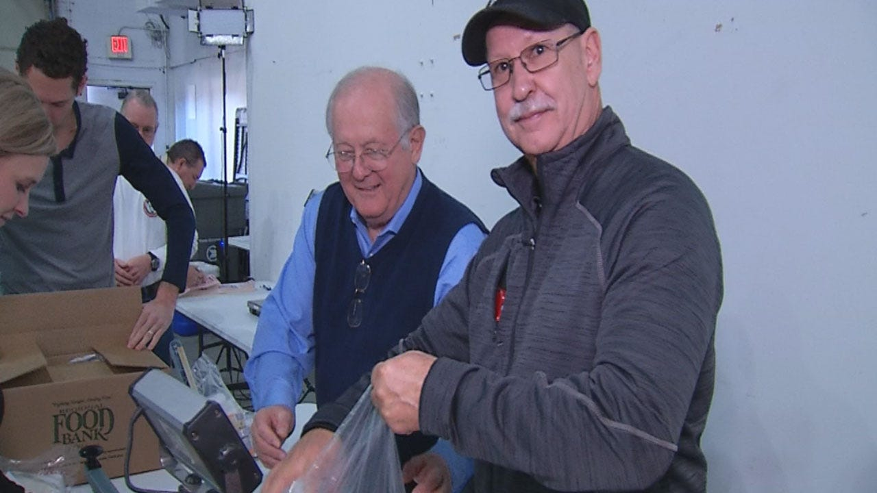 News 9 Employees Pack Backpacks For Regional Food Bank