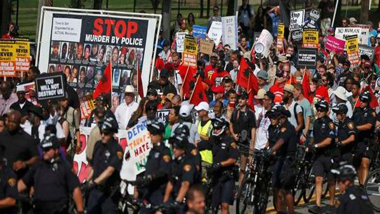 Police Break Up Scuffles Between Protesters Blocks From RNC
