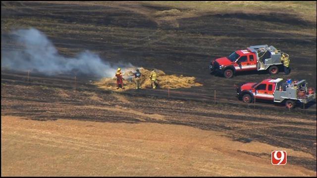 Multiple Crews Battle Grass Fire West Of Mustang