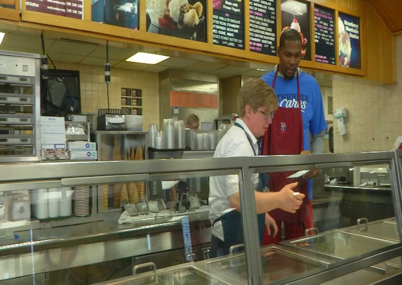 Thunder Players Work Behind The Counter Of Metro Business