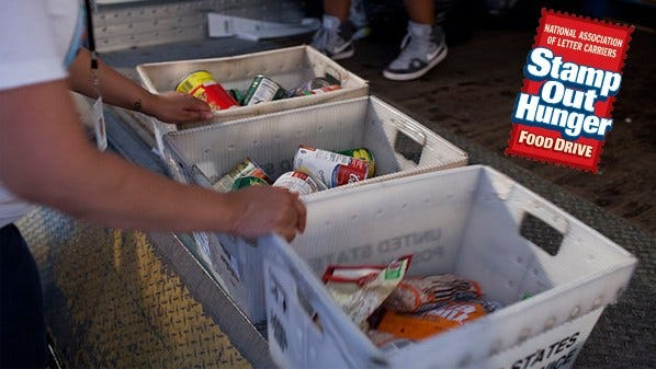 Letter Carriers Collect Canned Goods
