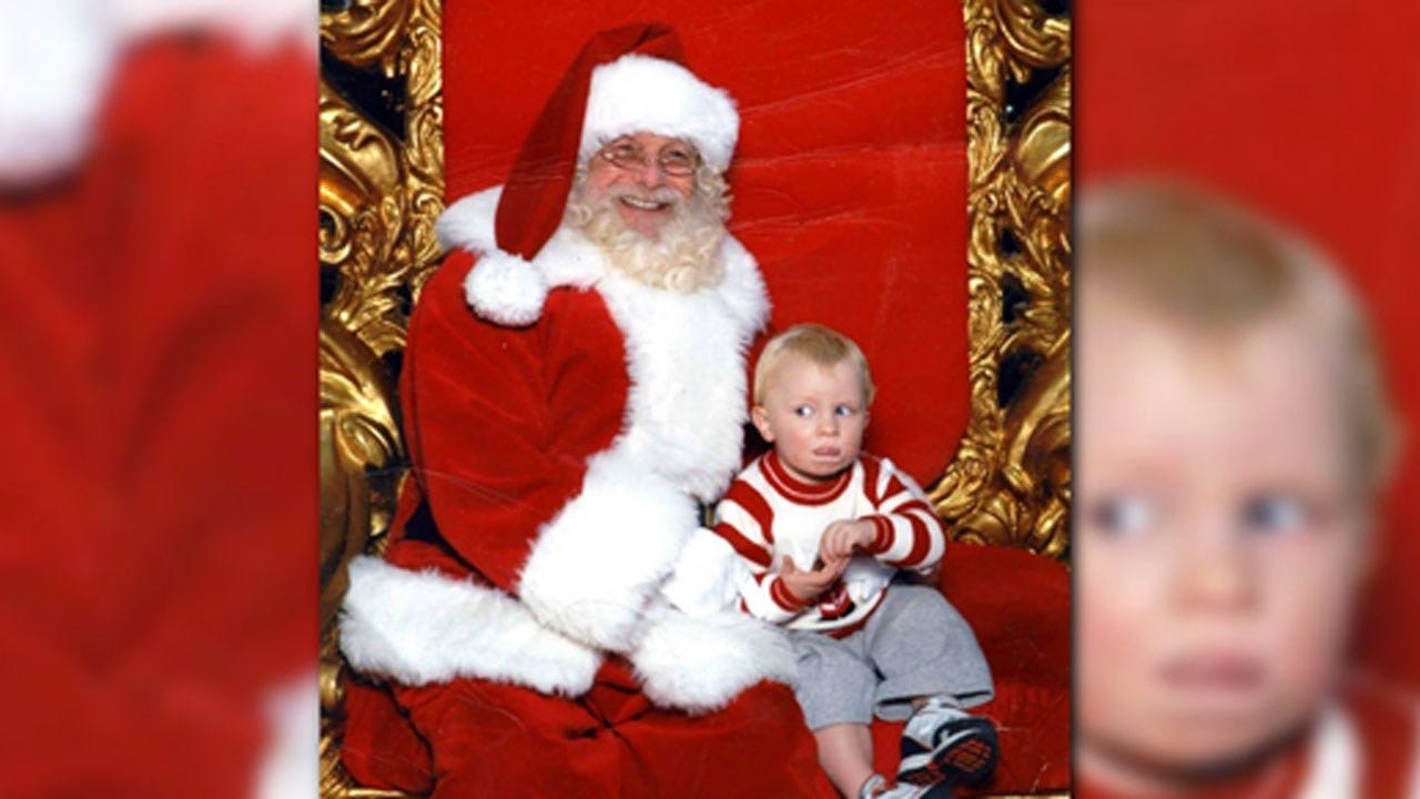 Toddler Signals 'Help' In Sign Language While Sitting On Santa's Lap
