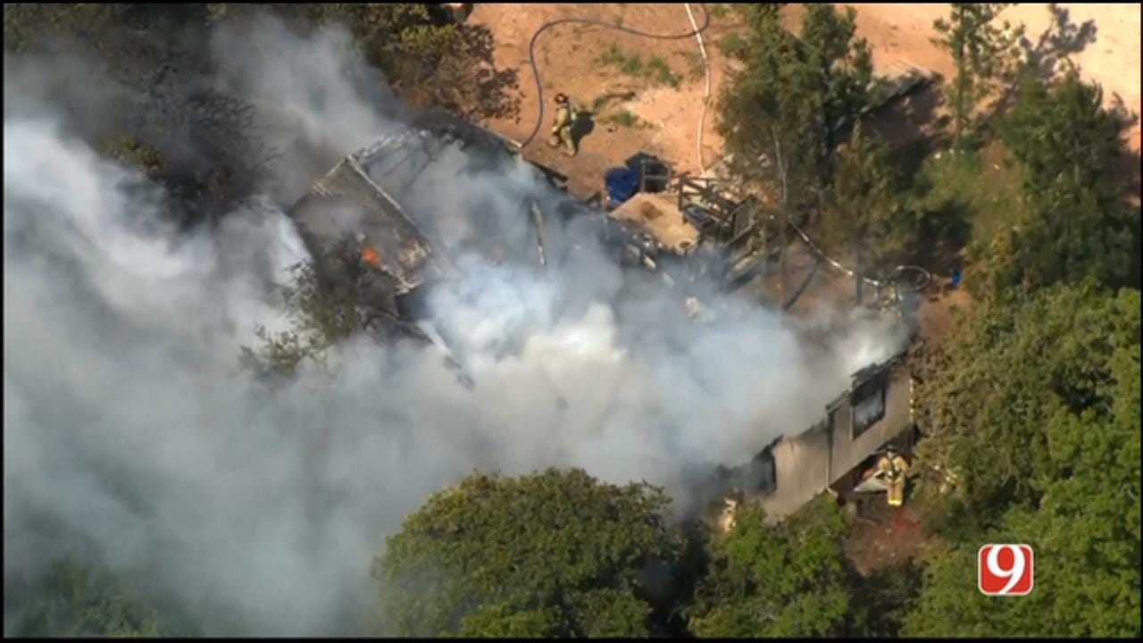Firefighters At Scene Of Norman House Fire