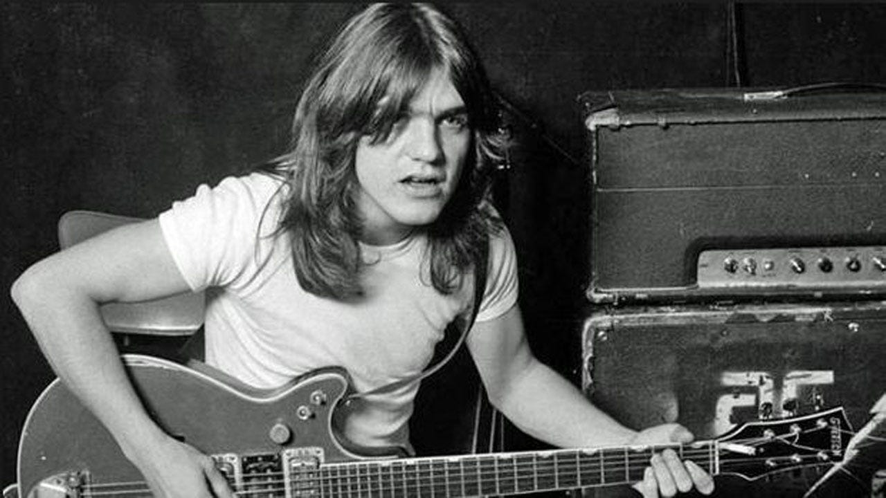 Malcolm Young, AC/DC Guitarist And Co-Founder Dies At Age 64