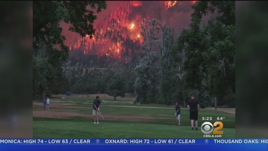 Golfers Finish Their Game As Wildfire Rages In Background