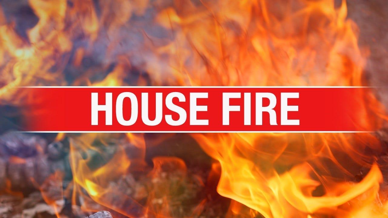 Fire Crews Battle Defensive House Fire In Mustang