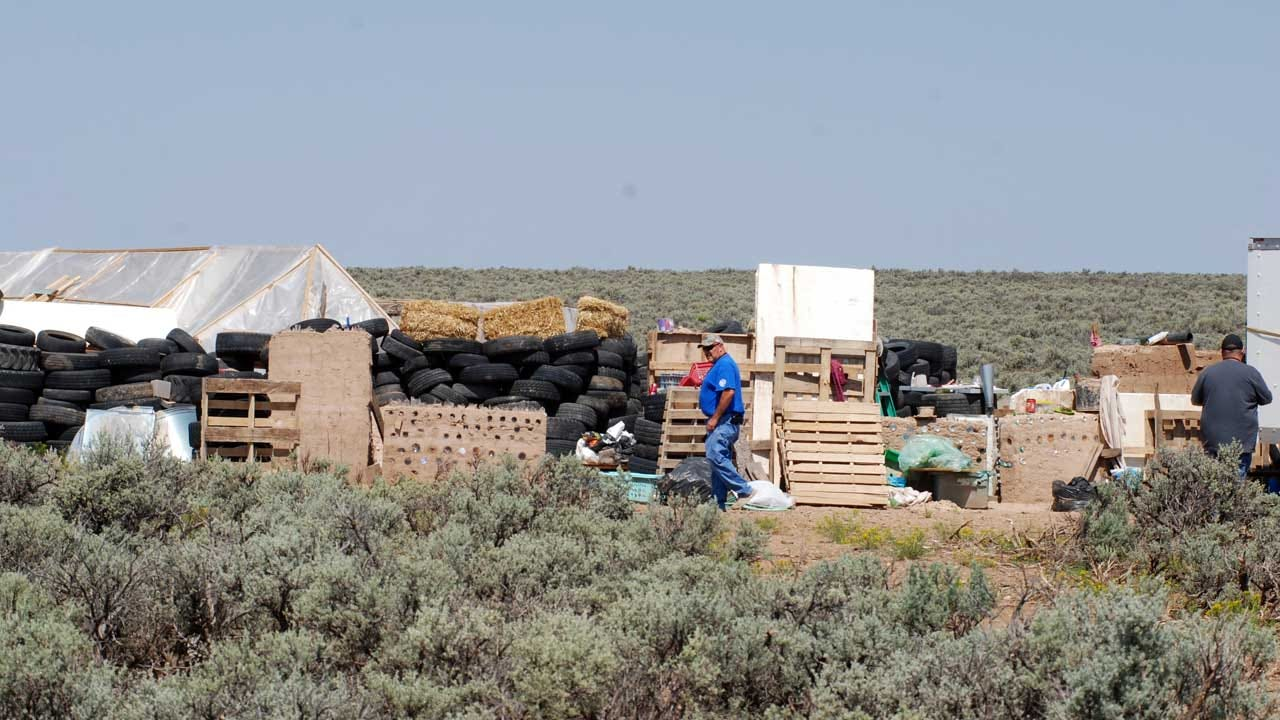 Inside The Remote New Mexico Compound: Ammo, Toys And Books On Assault Rifles