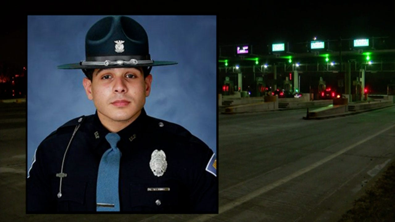 Indiana State Trooper Saves Woman Pinned By Car At Toll Booth