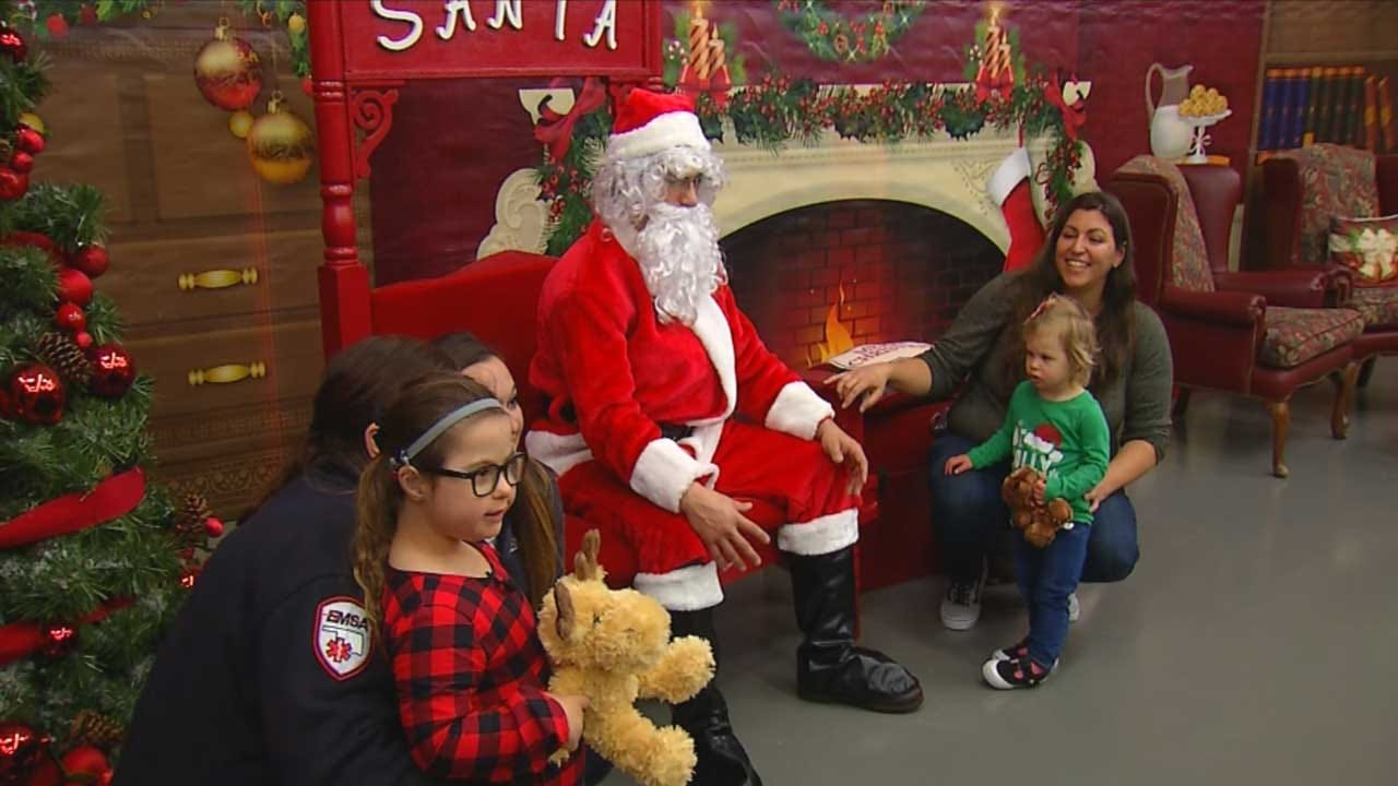EMSA Takes Young Girl With Special Needs To Meet Santa
