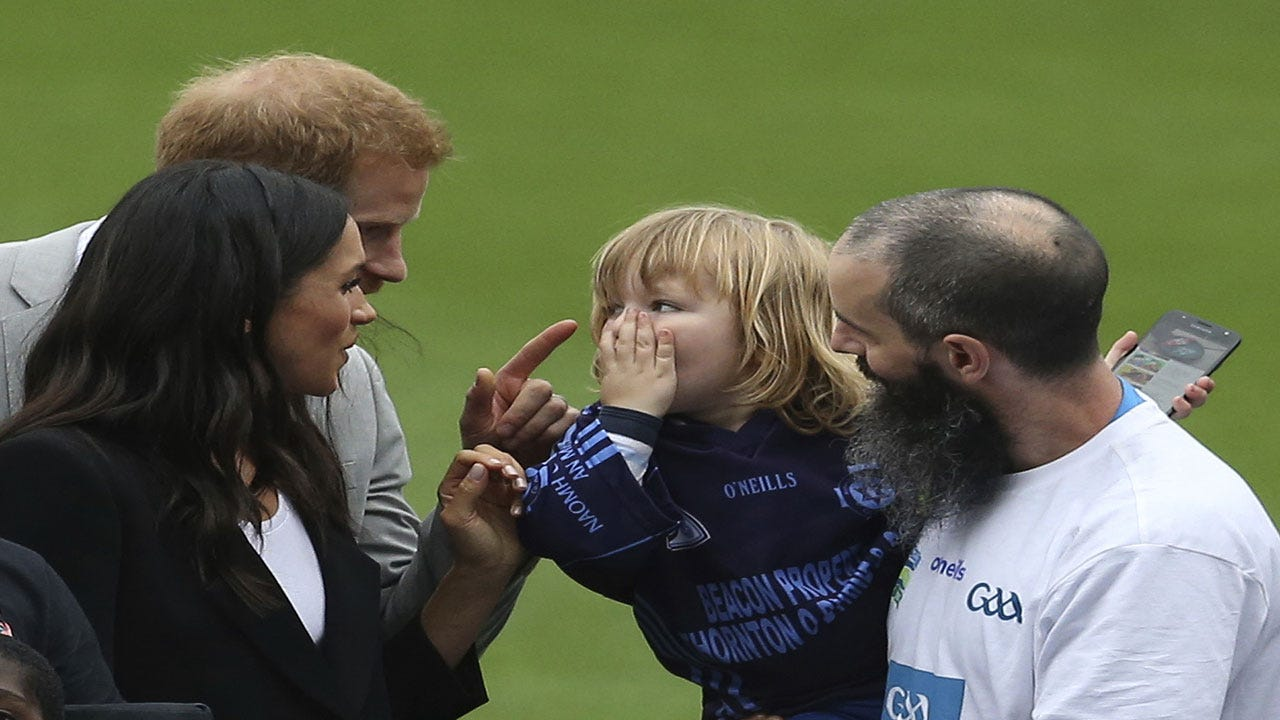 Little Kid Can't Stop Touching Meghan Markle's Hair, Prince Harry Jokingly Scolds Him