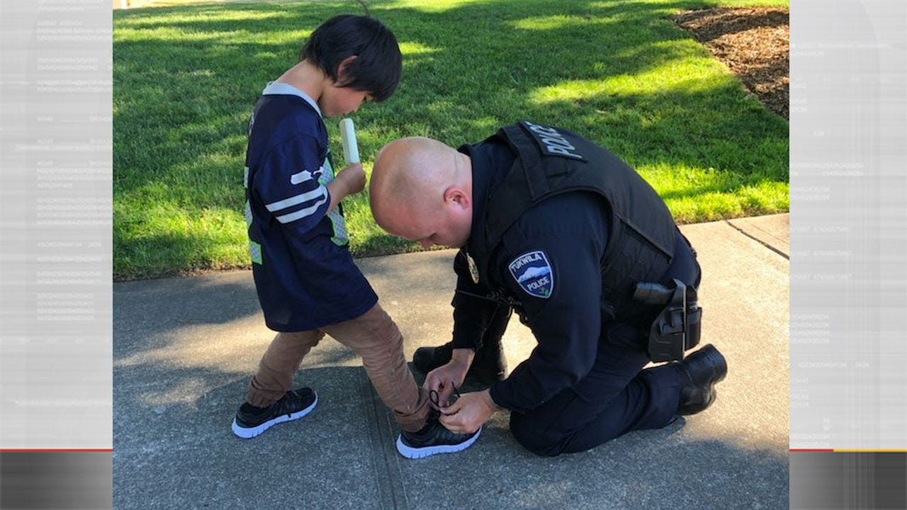 Officers Buy Shoes For Child In Need