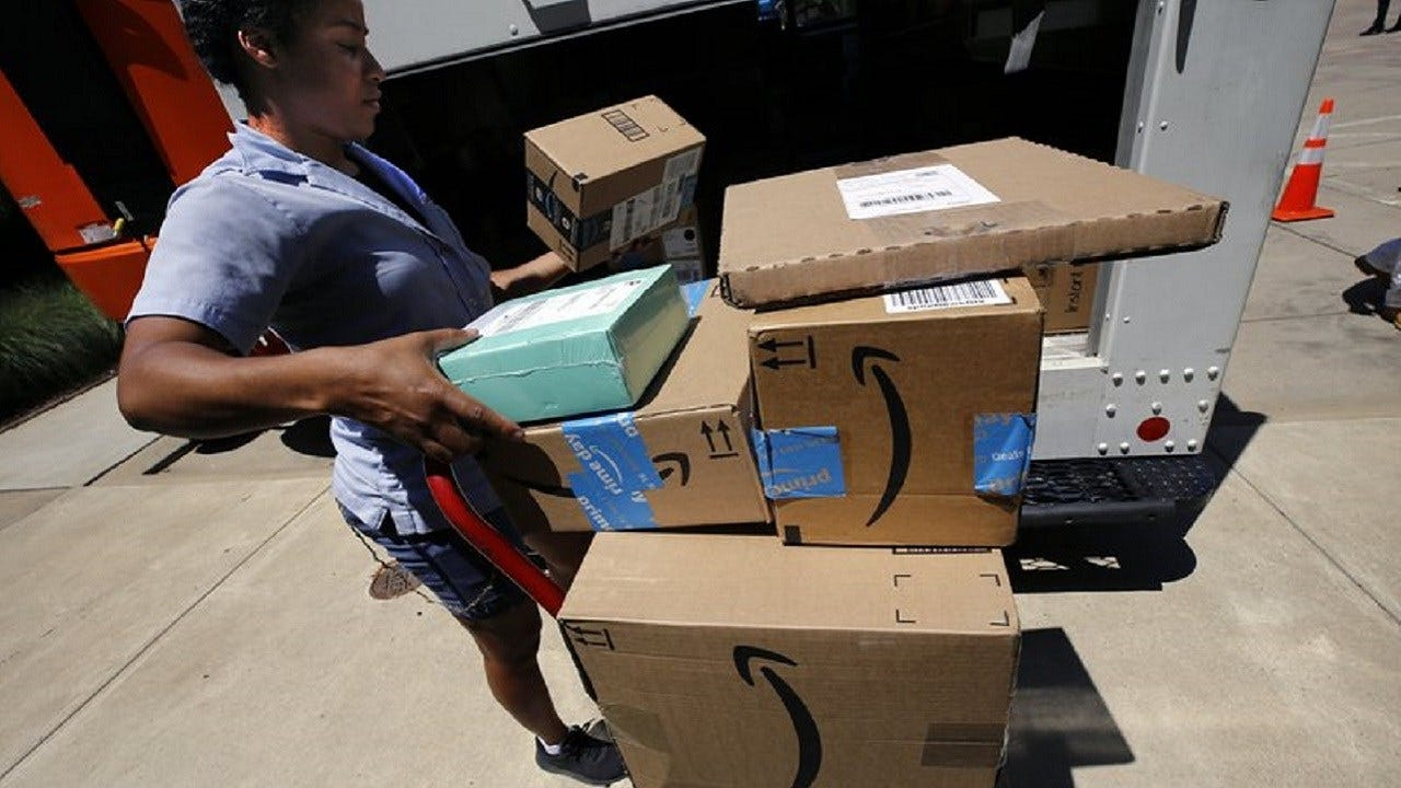 Amazon's Quarterly Profit Tops $2B For First Time