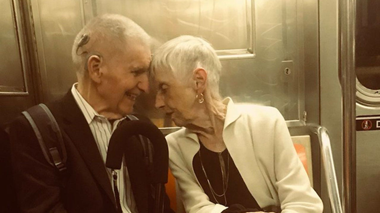 Nurse Captures Heartwarming Photo Of Elderly Couple In NYC Subway