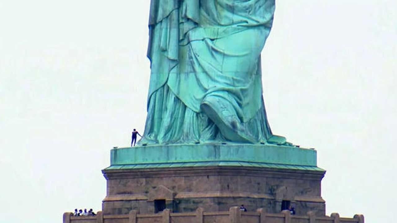 Liberty Island Evacuated After Woman Climbs Onto Statue of Liberty Pedestal