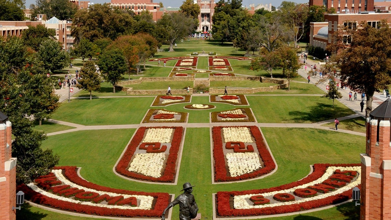 OU Staff Making Campus Move-In Easier By Lifting Students Boxes