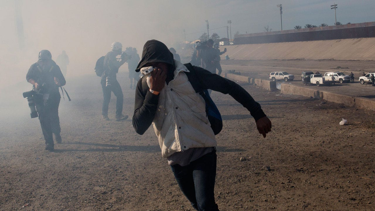 U.S. Agents Use Tear Gas As Some Migrants Try To Breach U.S.-Mexico Border