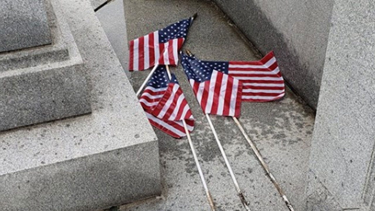 Report Of Man Urinating On US Flags At Veterans' Cemetery Under Investigation