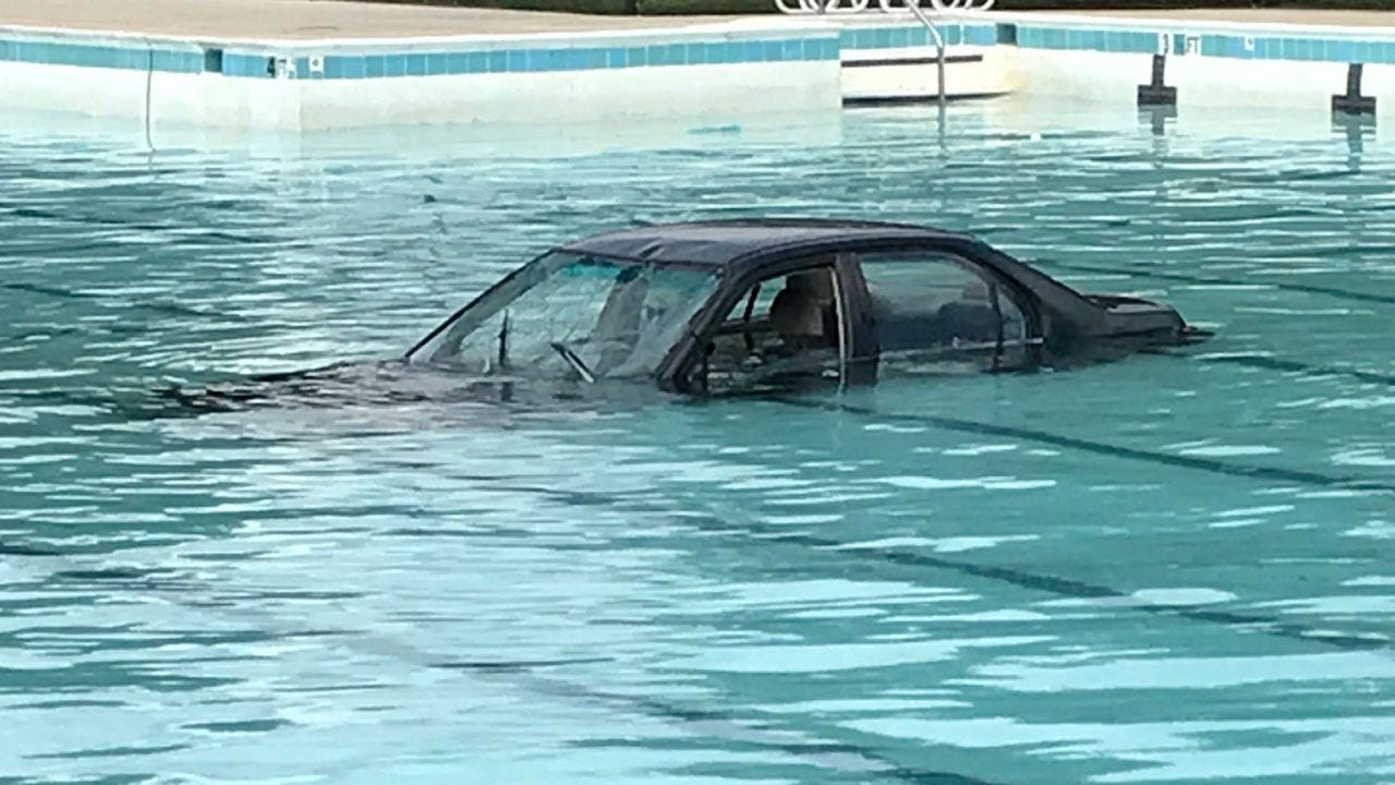 Driving Lesson Ends With Car Landing In Swimming Pool