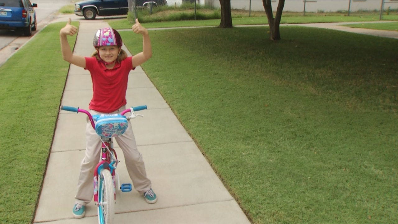 Deputies, School Crossing Guard Buy Young Girl New Bike