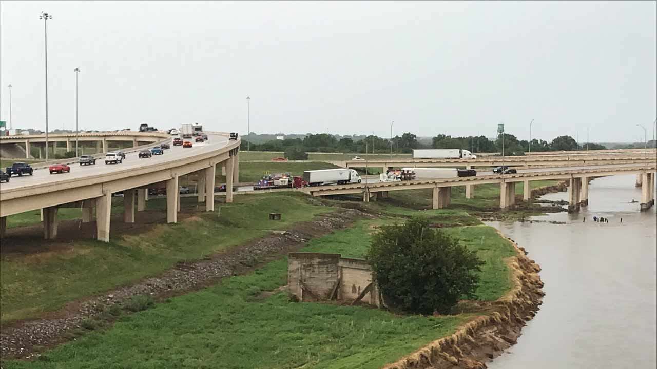 Semi Rolls Over On I-40, Possibly Leaking Oil Into River