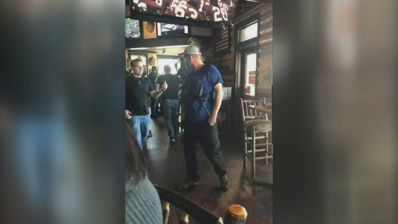 Concerns Over Permitless Carry Growing After Viral Video, Pictures Of Man Carrying AR-15 In OKC Surface