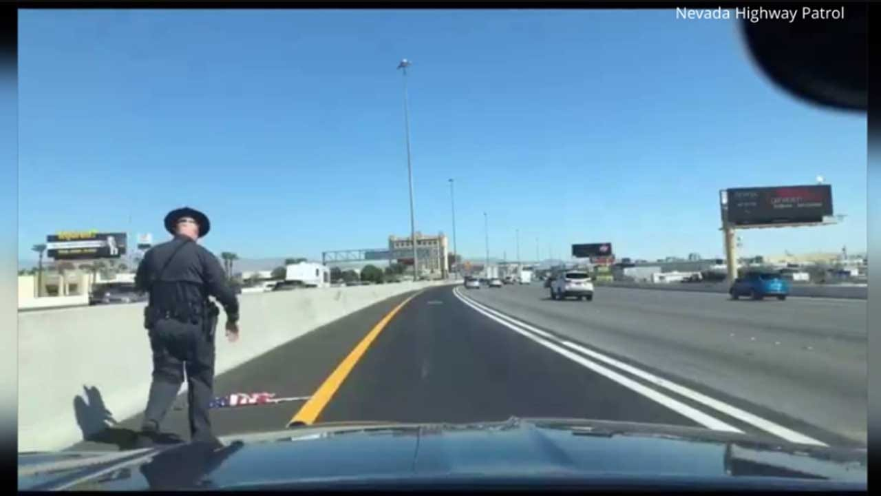 Trooper Caught On Dashcam Pulling Over To Save American Flag On Highway