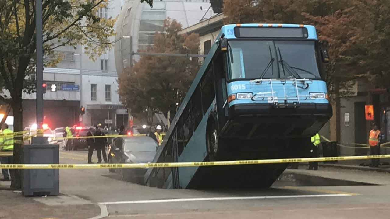 Sinkhole Opens, Swallows Part Of City Bus During Rush Hour
