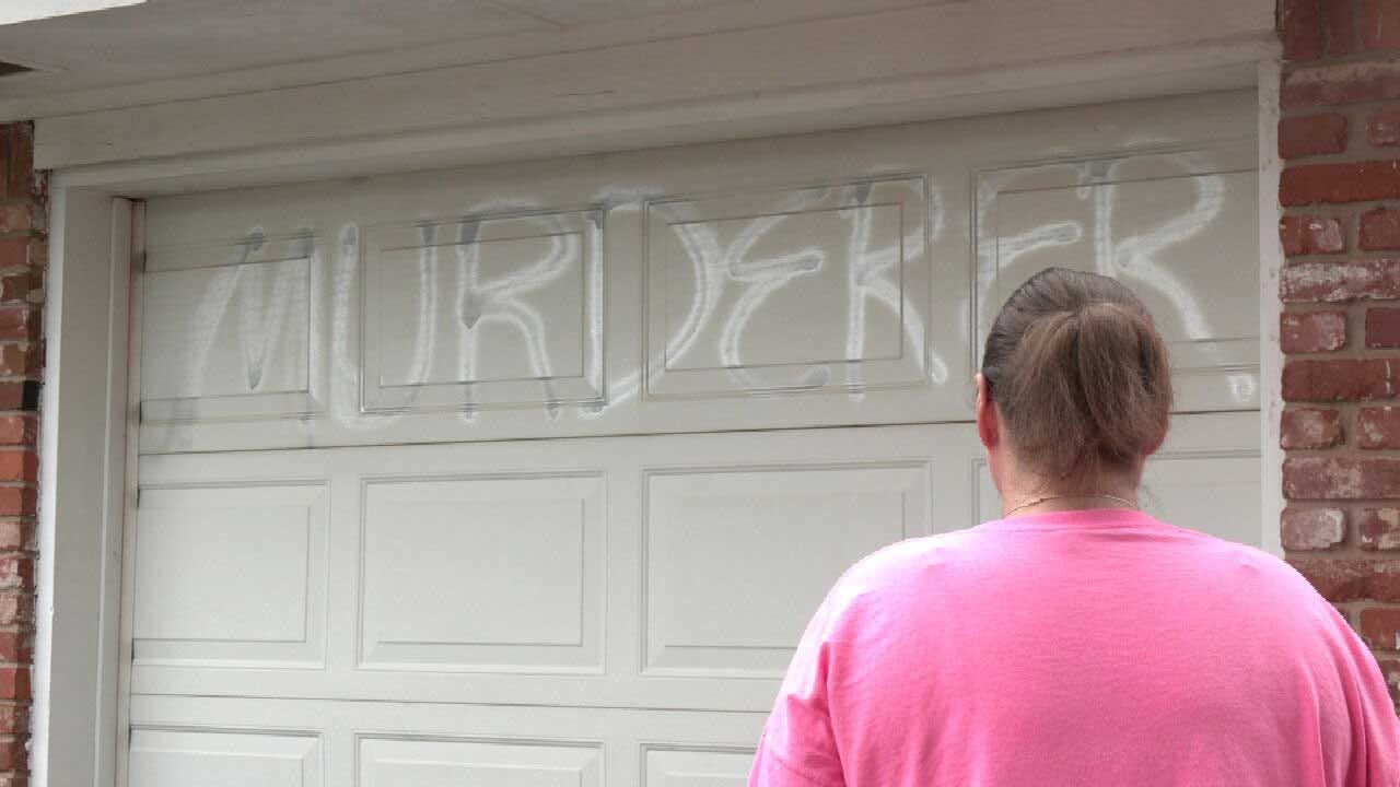 Del City Couple Fears For Safety After Catching Landlord Spray Painting 'Murderer' On Their Garage Door