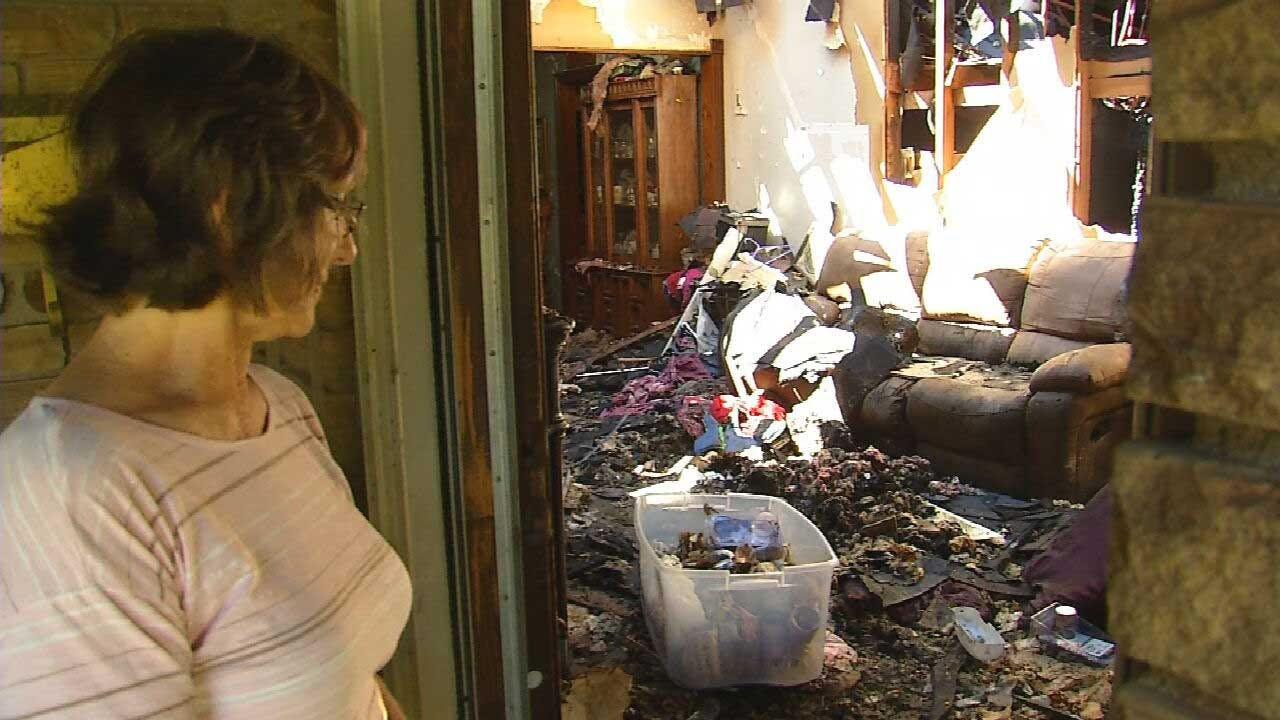 Community Helping Family After Home In The Village Destroyed By Fire