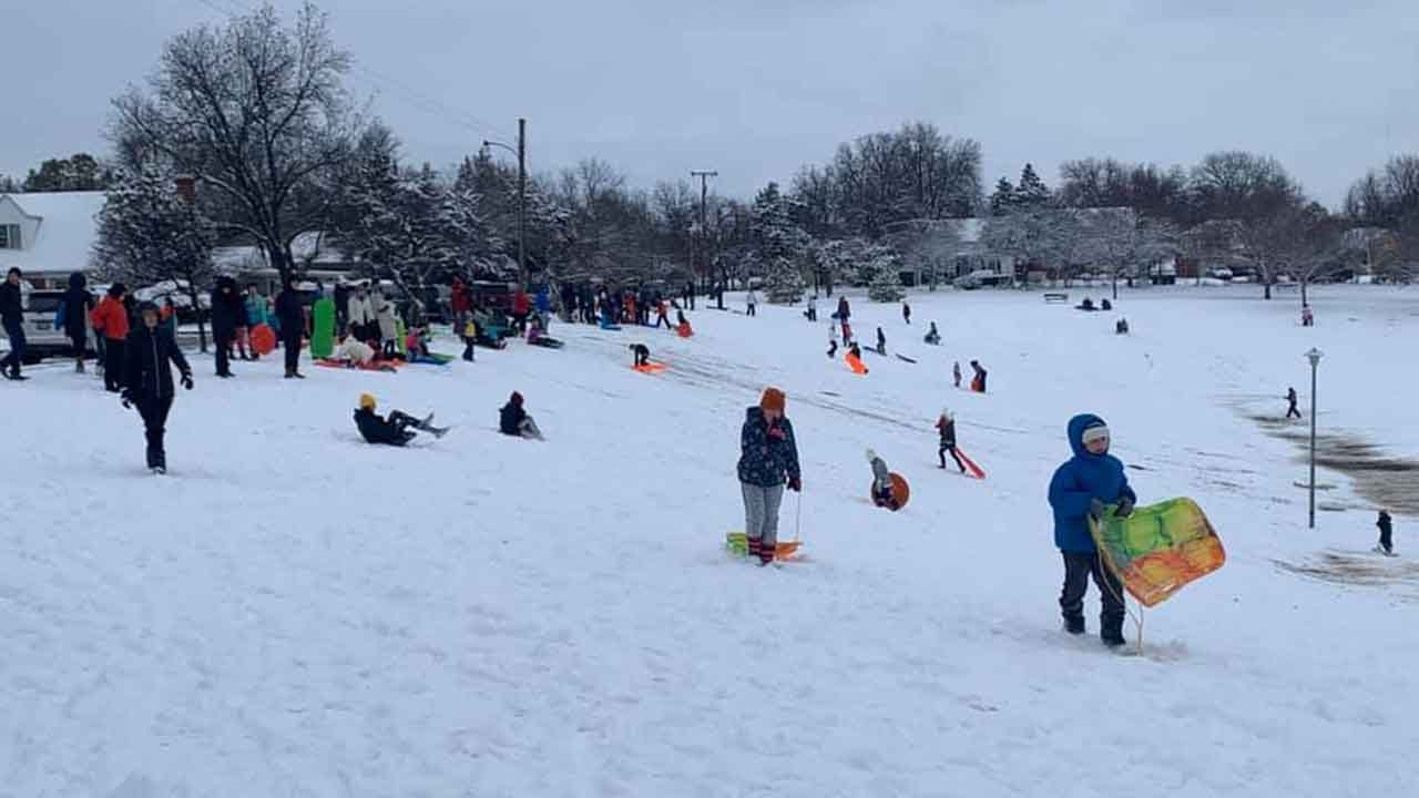 Families Gather To Sled At NW OKC Park For Snow Day